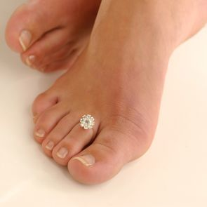 A pedicure with bling on the toe