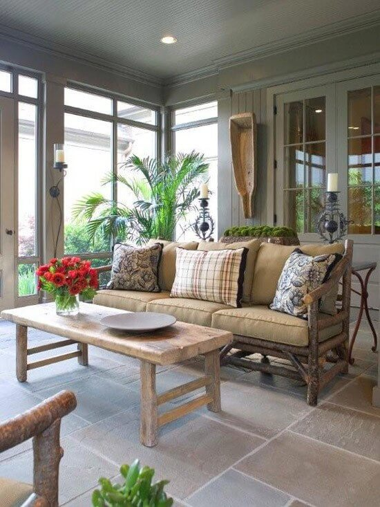 This Southern porch was created by Grant Ray of Ray & Baudoin interior design.This in-and-out living space is an ideal example of the streamlined, sophisticated comfort that Grant Ray is known for in Memphis.