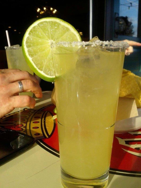 A nice tall glass of margarita with a fresh lime circle at Little Donkey. Photo credit: