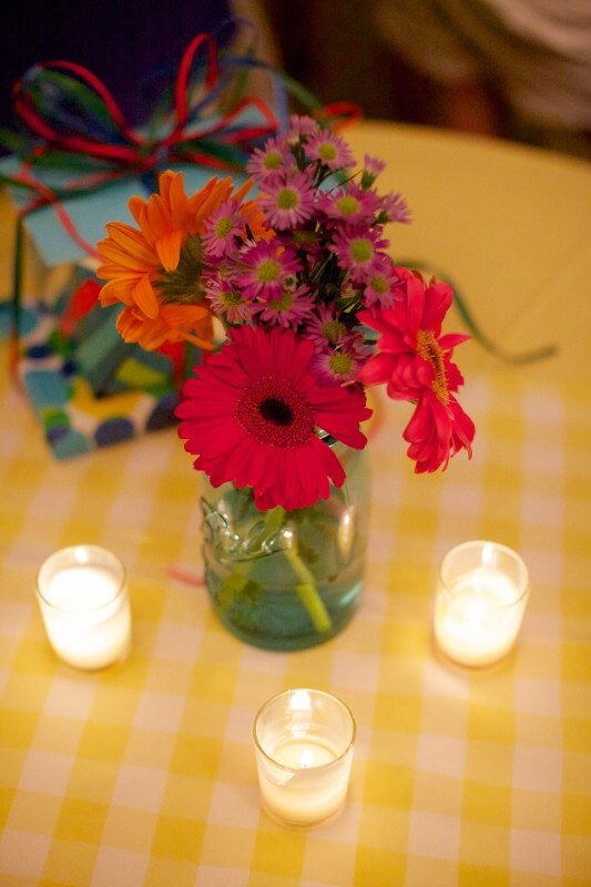 Simple floral arrangements adorned the tables.