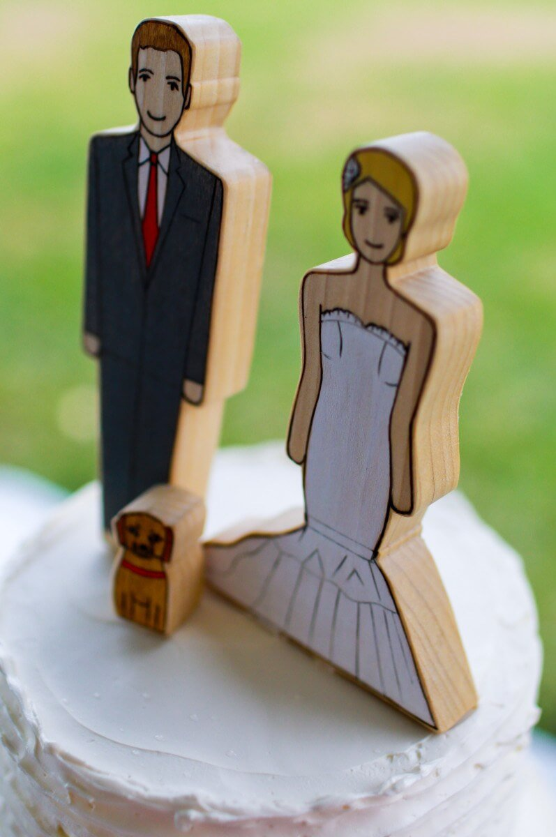 I saw the cake toppers on Etsy and knew I had to have them. The girl who did them was amazing and they came out perfect. She designed them from wood and painted them to look like Chris, Cullen and I. The cake toppers now live on the shelf in my den and I look at them every day and smile.