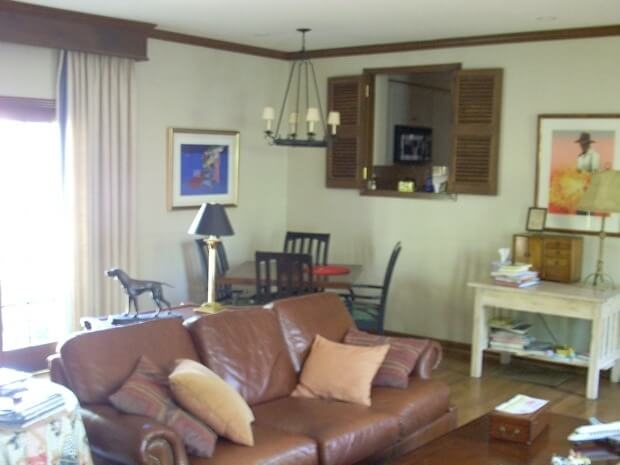 """""""Before"""" shot of the family room. The passthrough is into the kitchen."""