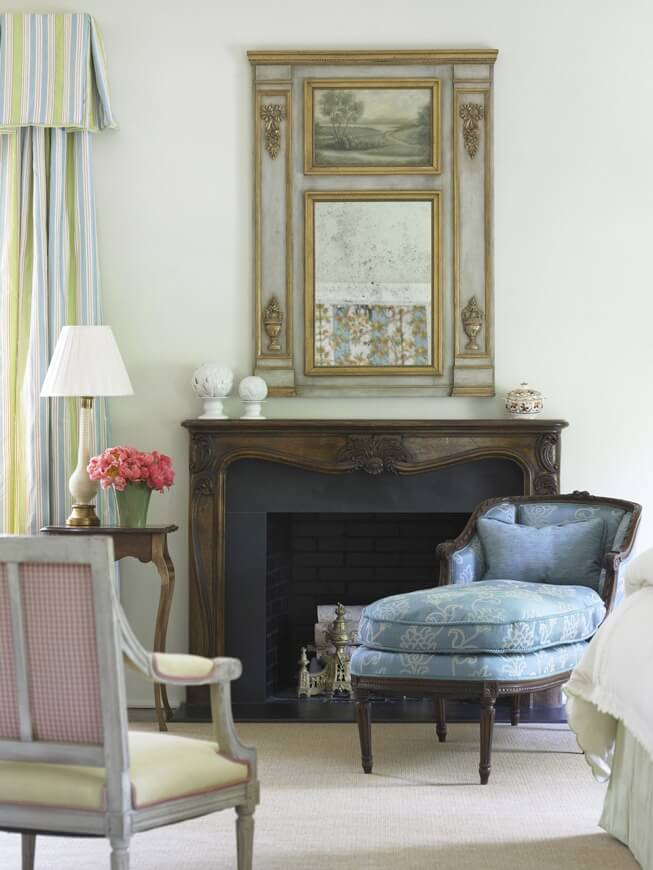 Before: The delicate mantel and elegant mirror reflect the refined sophistication of the entire space.