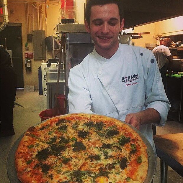 Chef Josh offers a slice from one of Strano's delicious pizzas.