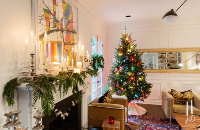 The big tree is found in the family room and Colleen says she like the vintage-inspired, colored lights. Garland, fresh greens and candles make up the bulk of the Christmas decor.