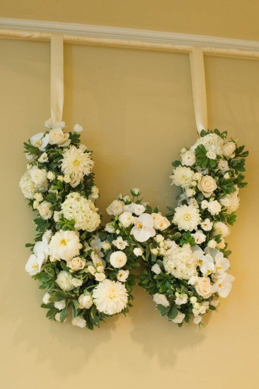 Even the flowers carried the monogram theme.