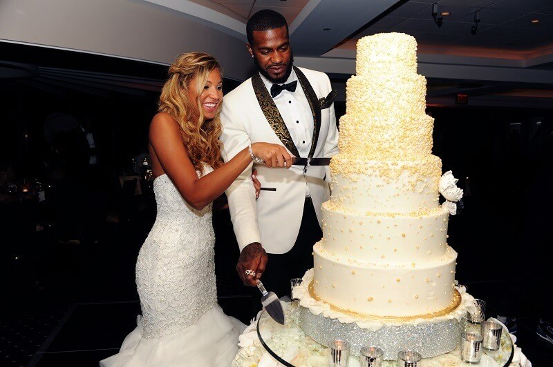 Hometown NBA Star marries in Louisville in a lavish wedding. Cake is the perfect size for them.