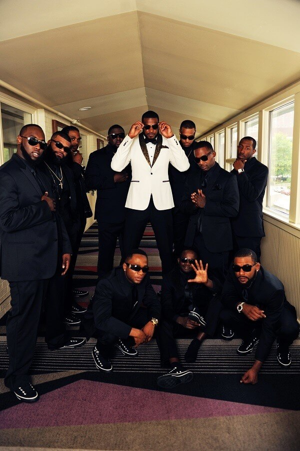 Hometown NBA Star marries in Louisville in a lavish wedding. The groom and his wedding party. Note their proximity to the ceiling. Each groomsman had customized Chuck Taylor shoes with their initials on them.