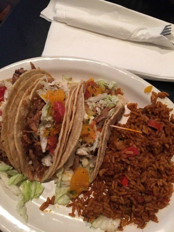 Once only offered as a seasonal special, the pork tacos were so popular that they are now a menu staple. The pork is roasted in-house, shredded and served on a layer of corn tortillas topped with a citrus salsa and served with a side of red rice.