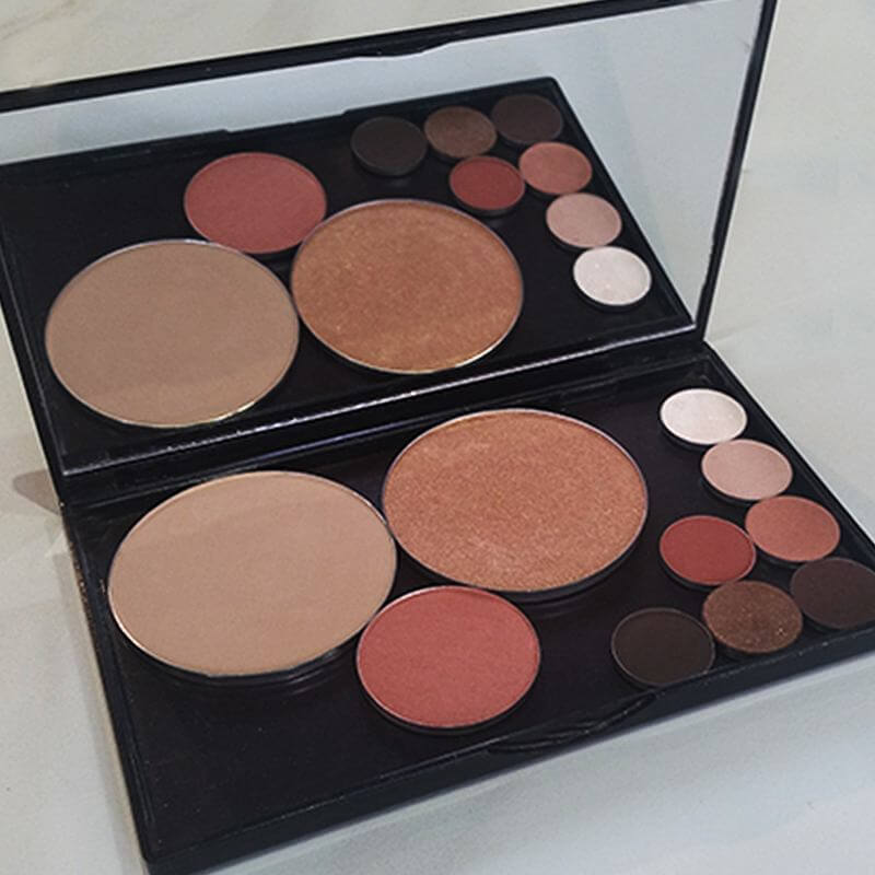 A palette for the beachy bride from Heather Cosmetics: Tender powder, Amber Glow highlightling powder, Pixie Diva blush and a grouping of eye shadows including hues such as Dazzle, Cashmere, Copper and more.