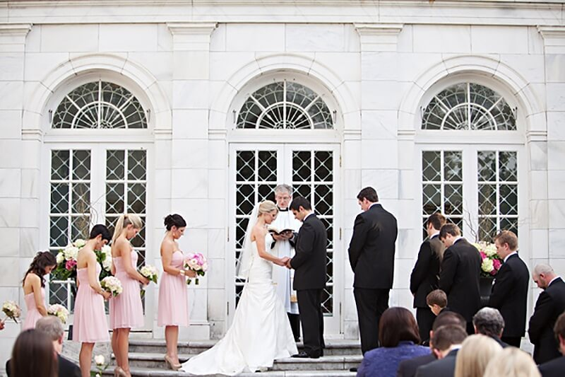 A wedding ceremony on the steps of the Brooks Museum | Image credit: Christen Jones Photography