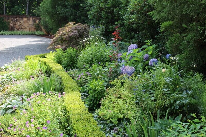 Blooms overflow in this perennial garden designed by Floralis.