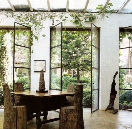Steel and glass windows are invaded by climbing vines  | styleblueprint.com
