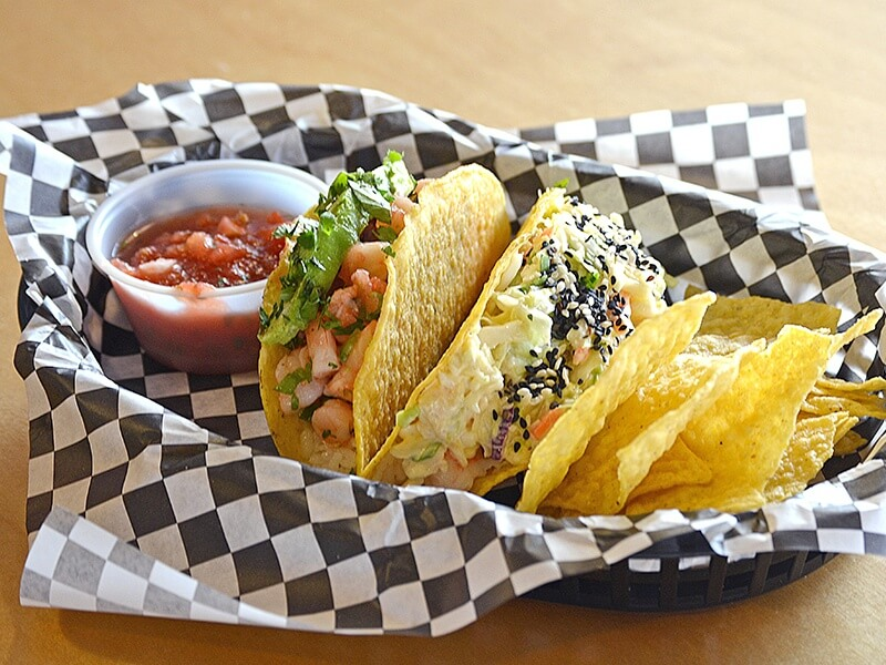 The 30-A taco features shrimp, avocado, slaw and sesame and the Ceviche showcases lime-marinated shrimp, avocado, tomato and jalapeno, served with a side of tortilla chips and house-made salsa.