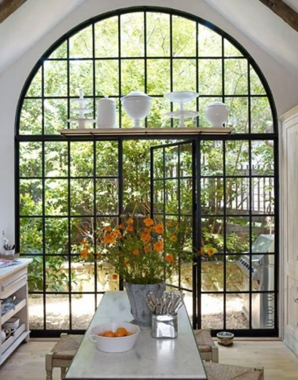 Arched window with glass and steel | styleblueprint.com