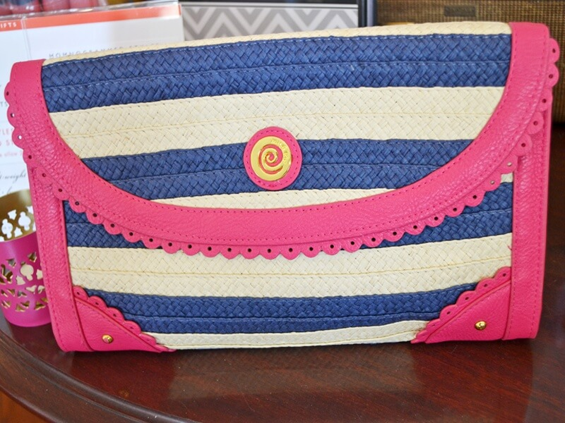 Cool Clutches for Summer:Straw navy and white clutch with pink trim at Cartwheels for $25.