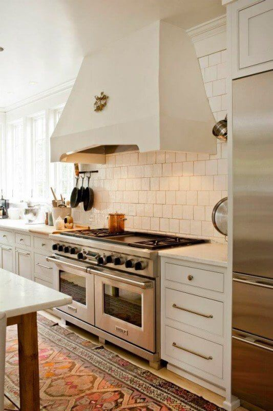 Cantley kitchen white tiles and white cabinets