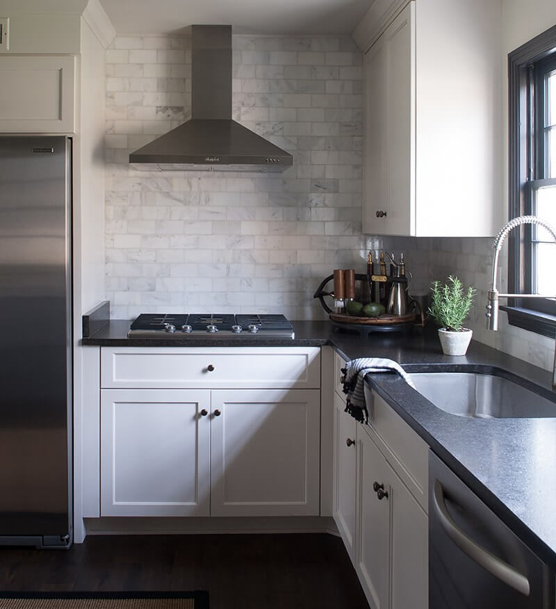 In the kitchen and laundry areas, Sean used black pearl granite countertops with a leathered finish. All countertops and tile in his home came from the Triton Stone Group.