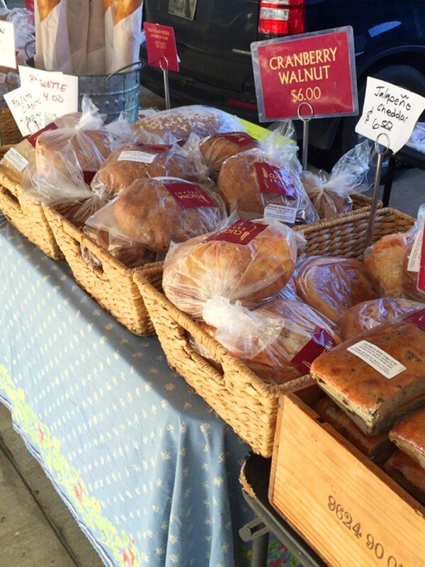 We recommend the rosemary olive oil and cranberry walnut bread from Cucina Breads., available at the Memphis Farmers Market.