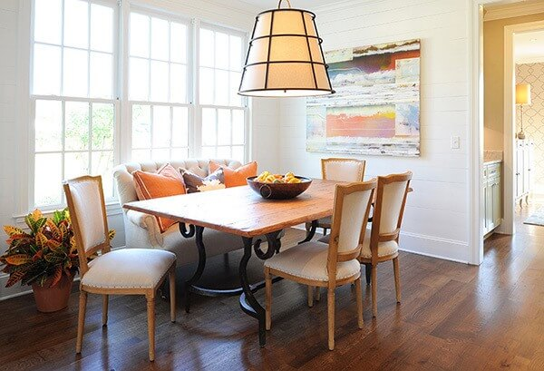 A bold use of color and modern elements in a breakfast area by Chestnut Hall interior designers Stacy McSpadden and Lana Zepponi