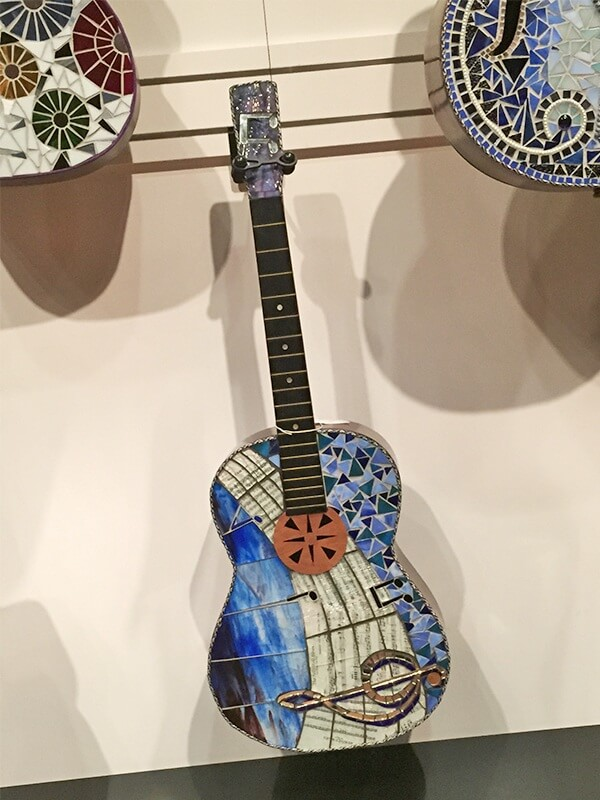 This L'il Boy Blues guitar is pure art. Find it Five and TENN for $1,200.
