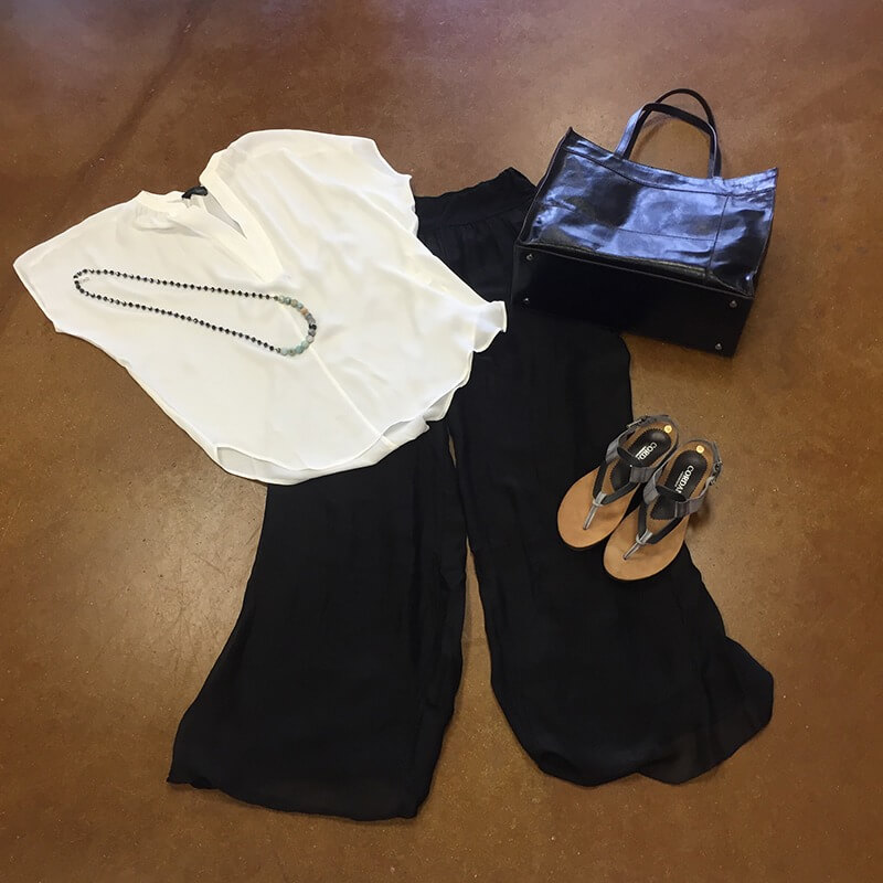 From Sorelle: A white Love Token top, $124, black Baci pants, $144, black Hobo bag, $248, and Sophia necklace, $88