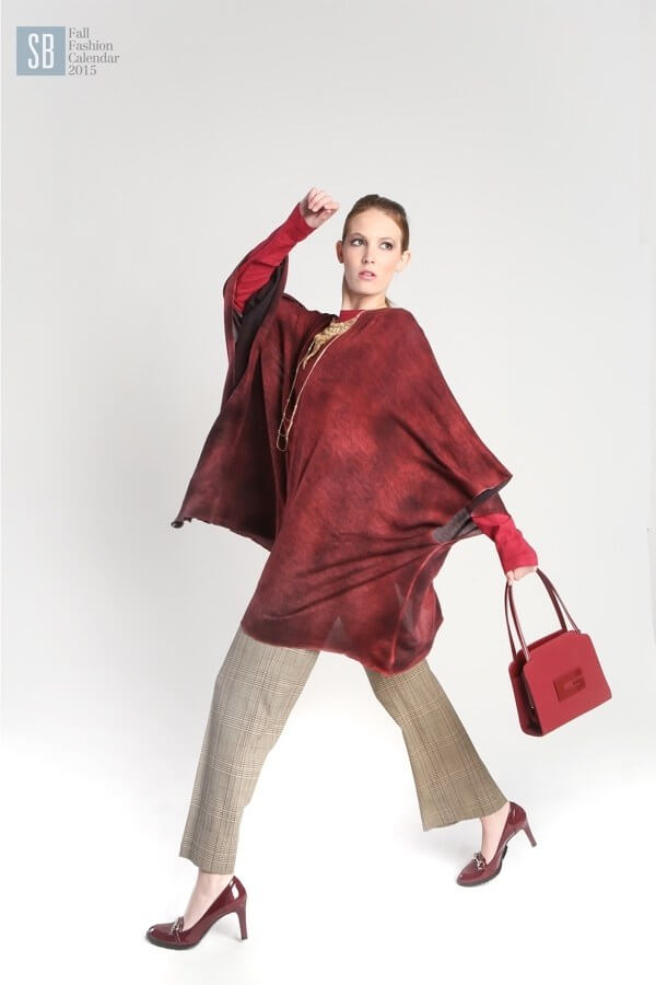 "Avant Toi masala poncho, $895 at <a href=""https://styleblueprint.com/nashville/guide/haven/"" target=""_blank"">Haven</a>; Wilt red pullover, $118 at <a href=""https://styleblueprint.com/nashville/guide/zelda/"" target=""_blank"">Zelda</a>; Moschino plaid pants (suit jacket not shown), $515 at <a href=""https://styleblueprint.com/nashville/guide/the-private-label/"" target=""_blank"">The Private Label</a>; Judith Bright Bar Fringe necklace, $498 at <a href=""https://styleblueprint.com/nashville/guide/judith-bright/"" target=""_blank"">Judith Bright</a>; Judith Bright 3-strand textured swing necklace, $188 at Judith Bright; Gucci red patent pumps, $125 at The Private Label; Gucci vintage burgundy handbag, $158 at The Private Label"