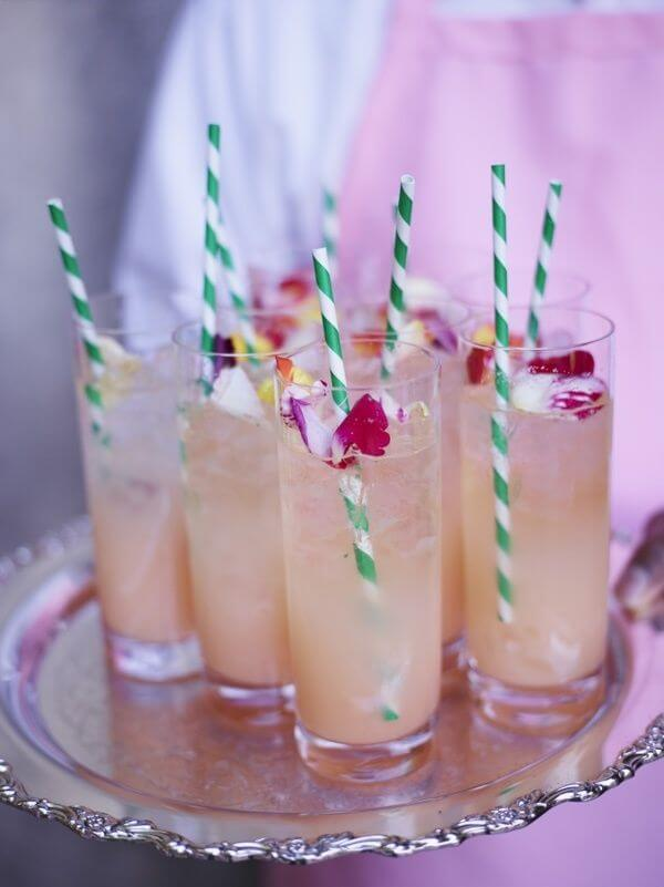 Let your caterer and bartender worry about creating the perfect seasonal cocktail, and you focus on the finishing touches—the silver tray, the cute straws and edible flowers.