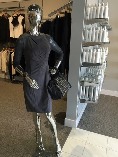 "For an air of sophistication, try a grey suede Elie Tahari dress $568, Retro Therapy cuff bracelet $145, and Linea Pelle purse $448 from <a href=""https://styleblueprint.com/memphis/guide/heather/"" target=""_blank"">Heather</a>."