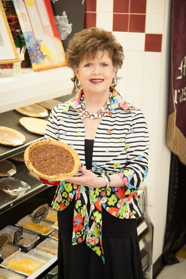 Daisy holds up a delicious pie, which you can purchase at Daisy's Kitchen, her store inside Grassland Foodland.