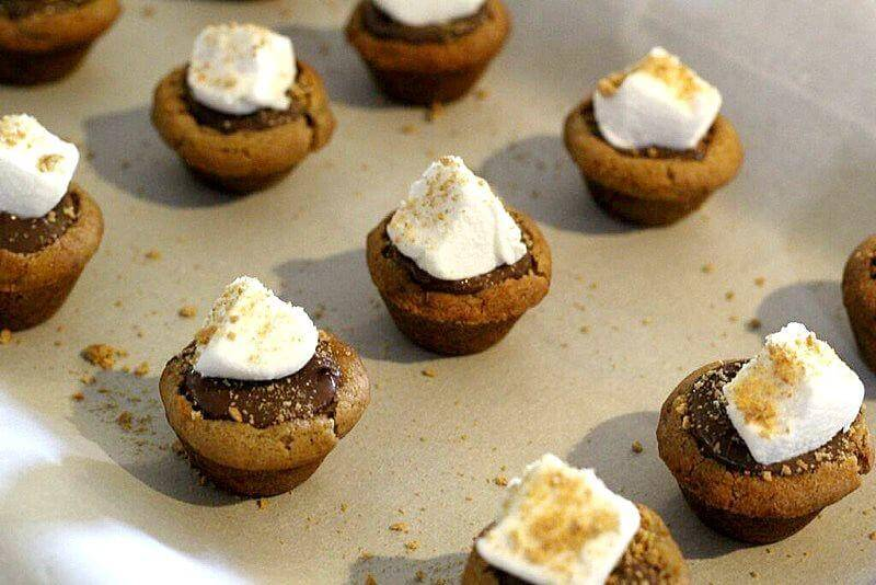 S'mores cookie cups with Nutella and marshmallows: Add a marshmallow, preferably cut so as to be extra sticky and hold more graham cracker crumbs.