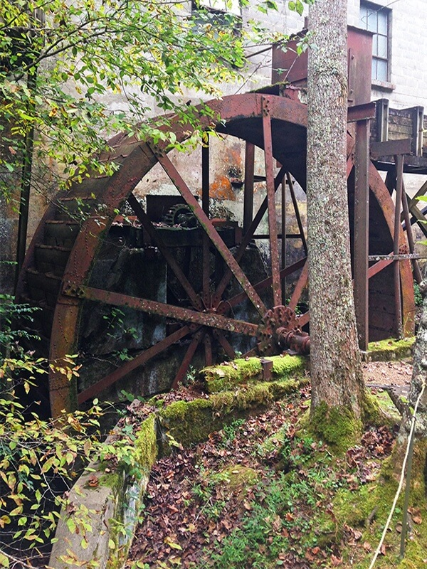 Rustic features like this old water wheel are all over the property.
