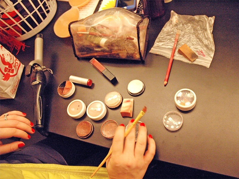 An actor's arsenal of stage make-up