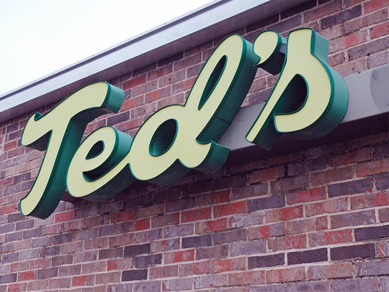 Ted's sign on the small, unassuming brick building that churns out Southern soul food every day
