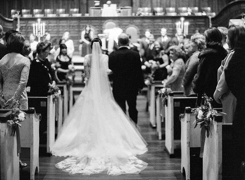 Natalie and her father process down the aisle in front of hundreds of friends and family.