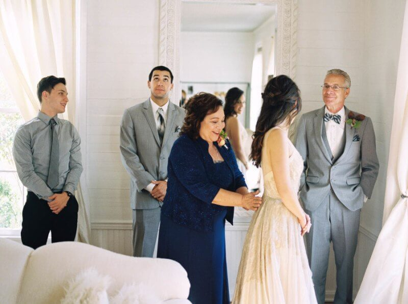 Jessica and her family admire her stunning bridal look.