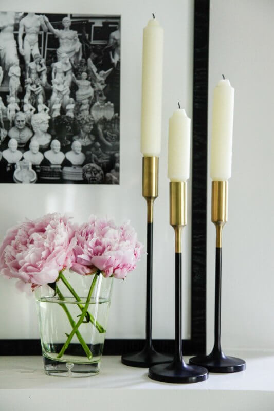 Three candlesticks and three peonies make for a stunning display. They also from the artwork in the background nicely: Sara Ray Interiors