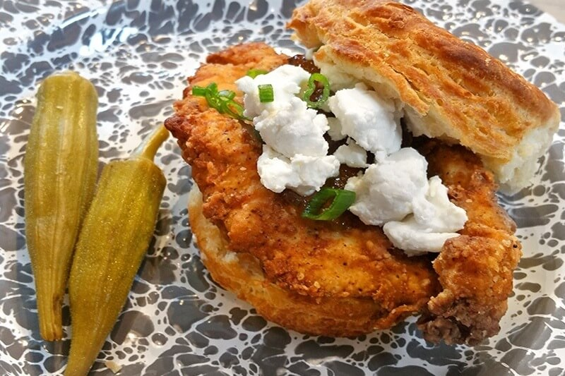 The Kickback Chicken biscuit at Holler & Dash includes fried chicken, goat cheese, sweet pepper jelly with a kick and green onions.