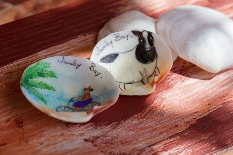 """Each night you'll receive a beautiful, hand-painted shell to bring home, and I always look forward to the bottle of Susie's Hot Sauce, made by a local Antiguan, that you receive upon departure,"" says Ashley Smith of Jumby Bay. ""The on-property boutique also has really pretty, breezy dresses and colorful jewelry that's great for a souvenir or a gift to bring to a loved one."" Image: Jacob Termansen"