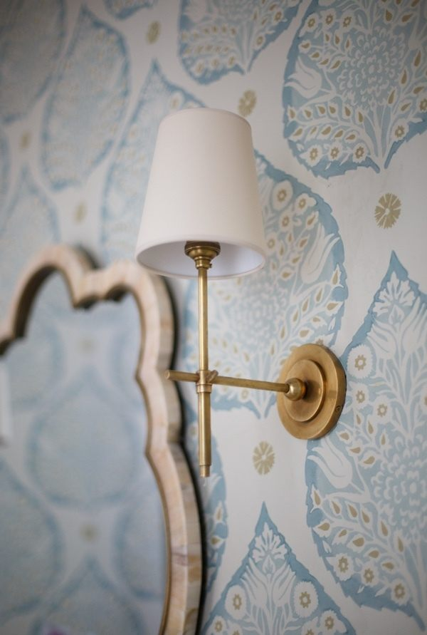 Antique brass sconces bring in some aged patina to the new house.