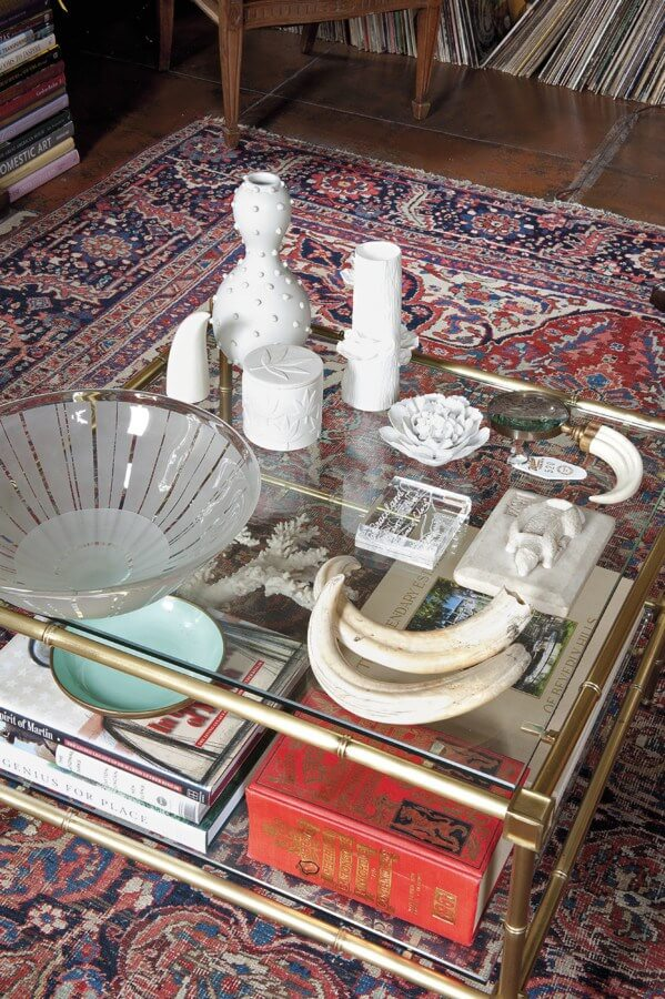"""This coffee table composition includes a Lucite box filled with dirt from Graceland, Kenyan boar tusks, modern porcelain pieces, including one by Jonathan Adler, a 1970s edition of Debrett's peerage,"" explains Susan."