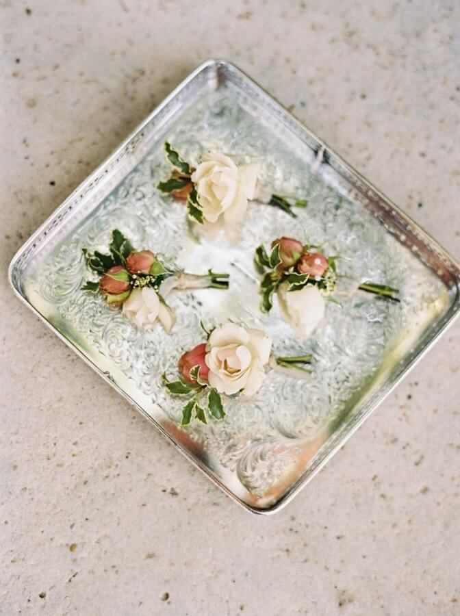 The groom is fiscally responsible for some flower duties — the bride's bouquet, the boutonnieres and the mothers' flowers. Image: Kirstin Sweeting Photography | Flowers: Holly Carlisle of Rosegolden Flowers