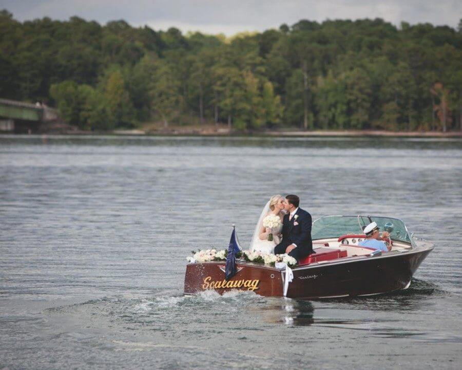 This couple's dream getaway vehicle for their lake wedding was a vintage boat! Image: Rob and Wynter Photography