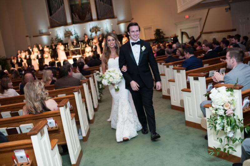 Lauren and John walking hand in hand for the first time as man and wife.