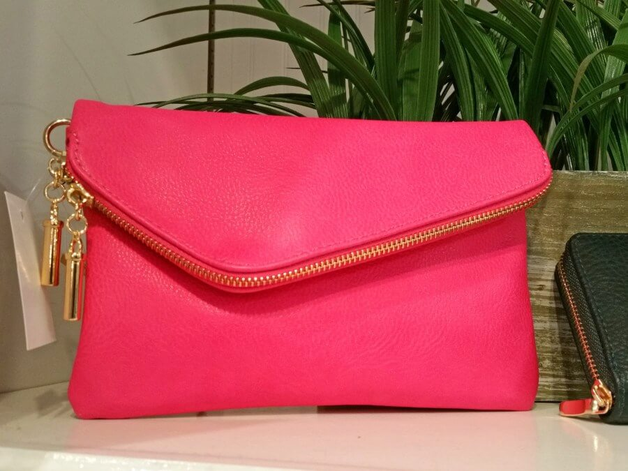 We love this hot pink clutch with asymmetrical zipper fold from Ellie!