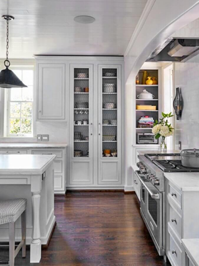 "Cantley & Company hides a recessed hood with a sheet-rock arch, adds nice mid-level lighting with the wall sconces and maximizes the wall space with inset shelving for a fully functional and pleasing kitchen! Image: <a href=""http://www.jeanallsopp.com"" target=""_blank"">Jean Allsopp</a>"
