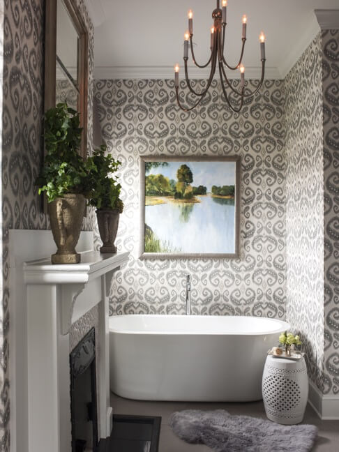 Wallpaper by Phillip Jeffries (phillipjeffries.com) covers the walls in this gracious master bath.
