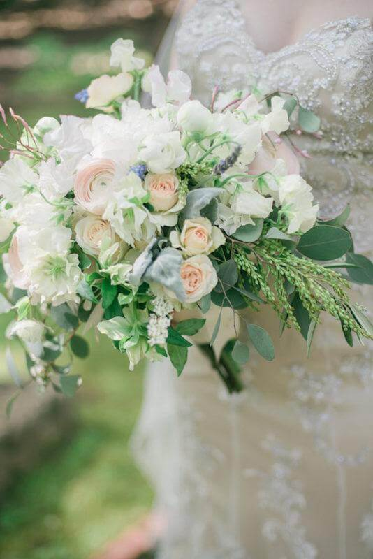 The bridal bouquet was the perfect accessory to Sarah's soft, classic style.