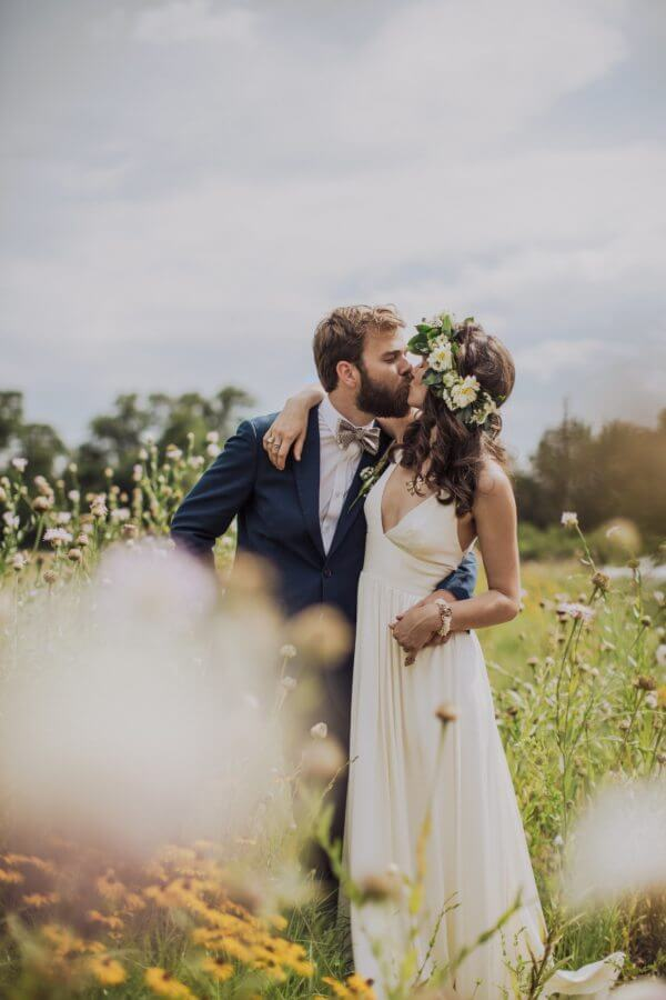 And they steal a kiss in a field of wildflowers!