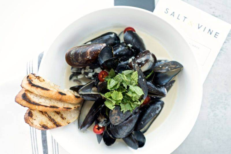 Green curry mussels kicked up with red pepper, cooled down with cilantro and mint.
